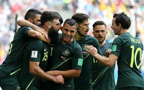 Mile Jedinak of Australia celebrates with team mates Andrew Nabbout, Mathew Leckie, Robbie Kruse and Mark Milligan after scoring his team's first goal during the 2018 FIFA World Cup Russia group C match between Denmark and Australia at Samara Arena on June 21, 2018 in Samara, Russia - Credit: Getty Images