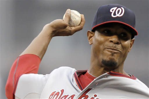 Washington Nationals pitcher Edwin Jackson throws in the first inning of a baseball game against the Pittsburgh Pirates in Pittsburgh on Tuesday, May 8, 2012. (AP Photo/Gene J. Puskar)