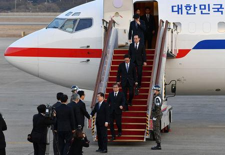 Chung Eui-yong, head of the presidential National Security Office, Suh Hoon, the chief of the South's National Intelligence Service, and other delegates arrive at a military airport in Seongnam, South Korea, March 6, 2018. REUTERS/Song Kyung-Seok/Pool