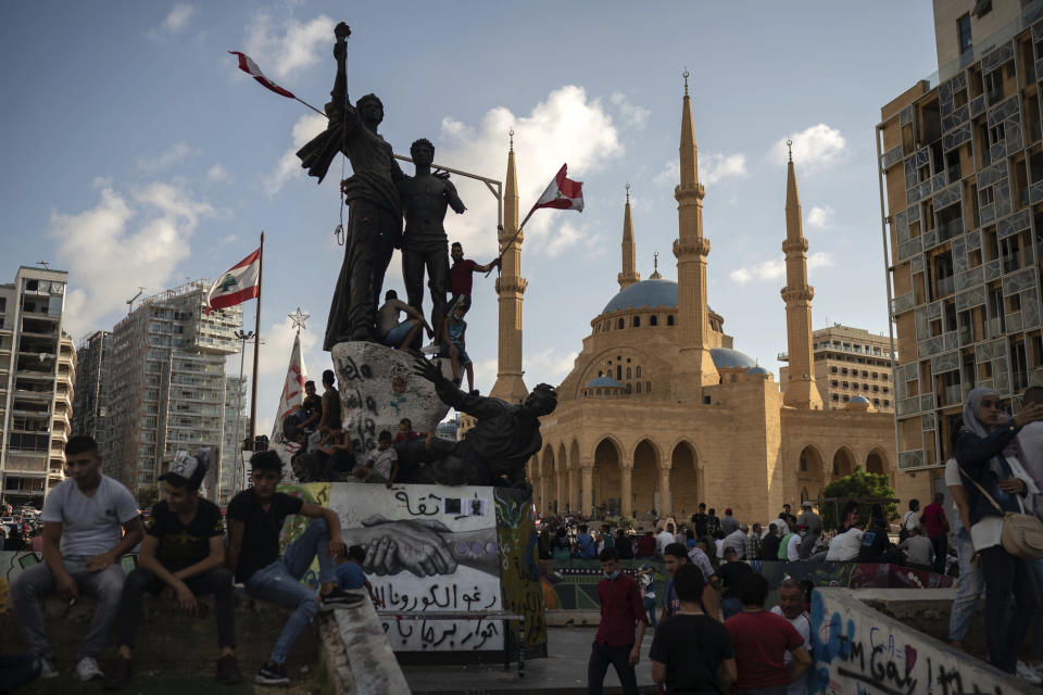 People gather at the Martyrs Square during a protest against the political elite and the government following last Tuesday's deadly explosion at the Beirut port which devastated large parts of the capital, in Beirut, Lebanon, Sunday, Aug. 9, 2020. (AP Photo/Felipe Dana)