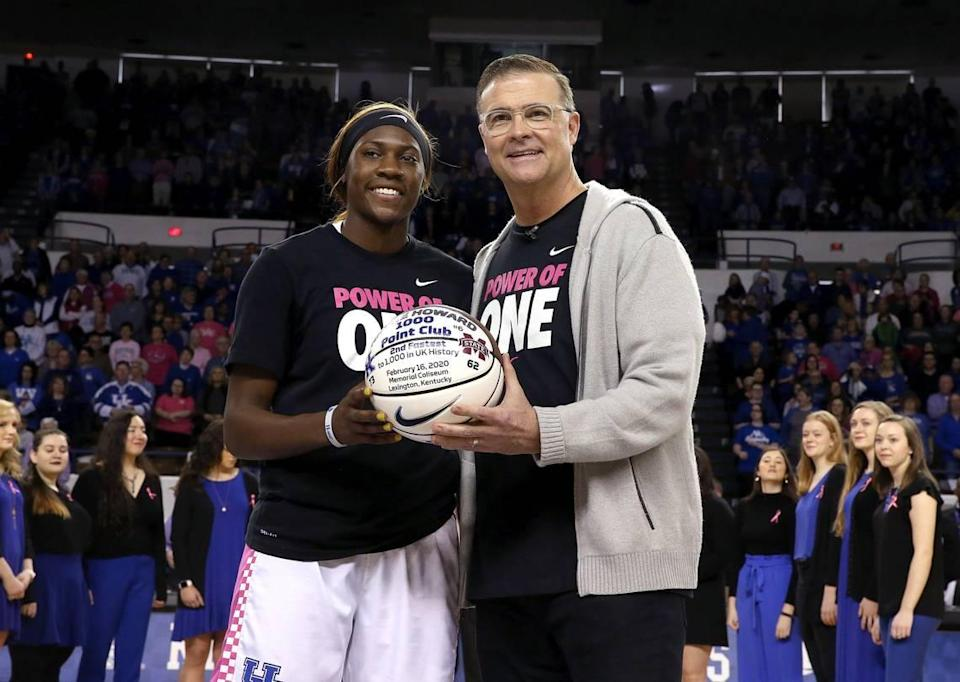 Now former Kentucky head coach Matthew Mitchell presented a basketball to current UK star Rhyne Howard to commemorate her joining the 1,000 career points club during the 2019-20 season. Howard is one of three players Mitchell coached at UK who won SEC Player of the Year honors.