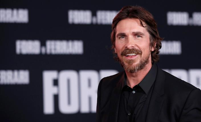 """Cast member Christian Bale poses at a special screening for the movie """"Ford v Ferrari"""" in Los Angeles, California, U.S., November 4, 2019. REUTERS/Mario Anzuoni"""