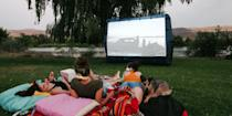 """<p>Whether it's a block party or an intimate date night, there's just something dreamy about watching a movie under the stars. It takes a little preparation and some purchasing power to <a href=""""https://www.howtogeek.com/227672/the-htg-guide-to-throwing-a-backyard-movie-night/"""" rel=""""nofollow noopener"""" target=""""_blank"""" data-ylk=""""slk:lay the foundation for your first screening"""" class=""""link rapid-noclick-resp"""">lay the foundation for your first screening</a>, but it's an investment that's well worth the time and expense. You'll need a projector with enough power to shine through the light pollution in your area and, of course, a surface to project the movie onto. Depending on your projector's capabilities, you may want to boost the volume with <a href=""""https://www.bestproducts.com/tech/electronics/g1329/best-outdoor-speakers-with-wires/"""" rel=""""nofollow noopener"""" target=""""_blank"""" data-ylk=""""slk:speakers"""" class=""""link rapid-noclick-resp"""">speakers</a>, too.</p><p>While you <em>could</em> project onto a flat wall, fence, or bed sheet, there's no doubt about it — you'll get the best picture quality with a screen. First, assess your space's access to a power source to decide if you want an inflatable or pulldown screen. Then figure out what surface you'll be sitting on, so you know how the screen can be stabilized. An inflatable screen, for example, will need a power source for its fan and grass or dirt for the stakes that support it. </p><p>Once you have the tech angles figured out, add in layers of comfort so that you and your guests can sit through a 2-hour movie without aching backs or bug attacks. Consider who is in your audience when you're deciding on seating. Adults will want supportive beach chairs or outdoor loungers, while kids can be comfy on the ground with blankets and pillows. </p><p><a href=""""https://www.bestproducts.com/home/outdoor/g1459/citronella-candles-to-keep-mosquitos-away/"""" rel=""""nofollow noopener"""" target=""""_blank"""" data-ylk=""""slk:Keep the citronella burning"""" c"""