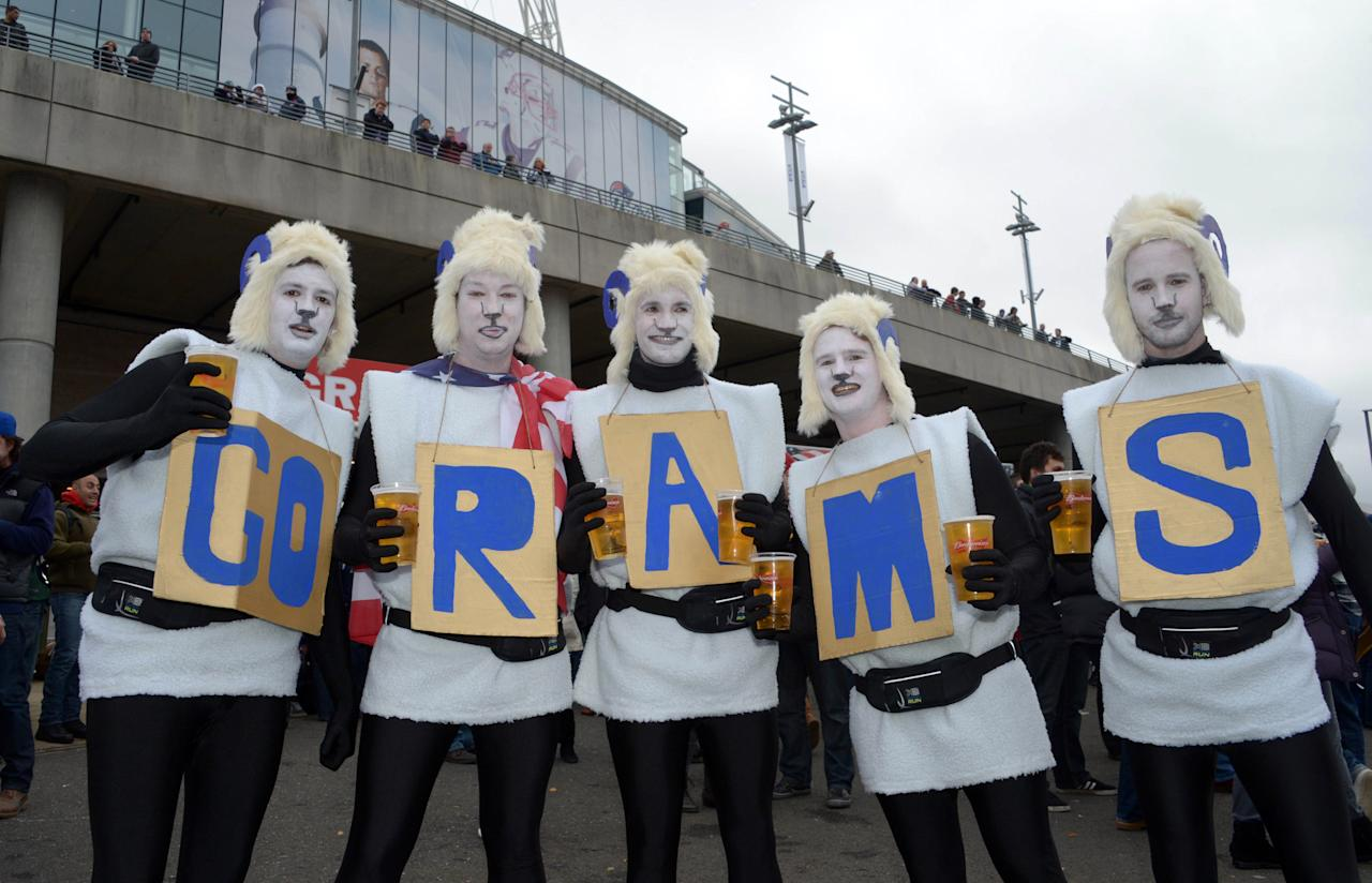 "Oct 28,2012; London, UNITED KINGDOM; St. Louis Rams fans in costumes and face paint spell out ""go rams"" during tailgate festivities before the 2012 NFL International Series game against the New England Patriots at Wembley Stadium. From left: Ben Caubrook (GO) , Dean Terry (R) , Jack Watson (A) , Glenn Barton (M) and Tom Overton (3). Mandatory Credit: Kirby Lee/Image of Sport-US PRESSWIRE"