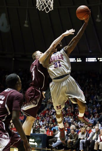 Mississippi State forward Colin Borchert (3) fouls Mississippi forward Murphy Holloway (31) in the first half of an NCAA college basketball game in Oxford, Miss., Wednesday, Feb. 6, 2013. (AP Photo/Rogelio V. Solis)