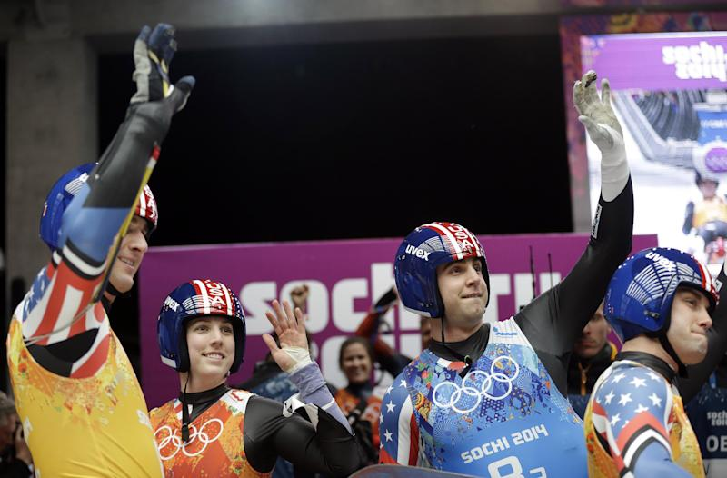 The United States team from left to right, Christian Niccum, Erin Hamlin, Christopher Mazdzer and Jayson Terdiman wave to the crowd after the luge team relay competition at the 2014 Winter Olympics, Thursday, Feb. 13, 2014, in Krasnaya Polyana, Russia. (AP Photo/Natacha Pisarenko)
