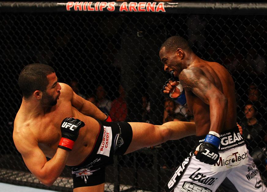ATLANTA, GA - APRIL 21:  John Makdessi (L) kicks Anthony Njokuani during their lightweight bout for UFC 145 at Philips Arena on April 21, 2012 in Atlanta, Georgia.