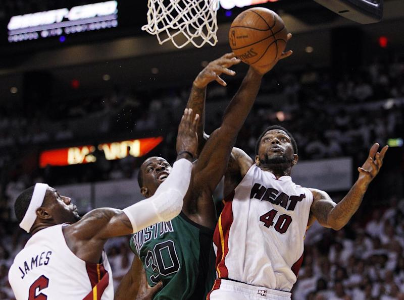 Miami Heat's Udonis Haslem (40) and LeBron James (6) pressure Boston Celtics' Brandon Bass (30) as he drives to the basket during the second half of Game 2 in their NBA basketball Eastern Conference finals playoffs series, Wednesday, May 30, 2012, in Miami. (AP Photo/Lynne Sladky)
