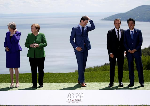<p>British Prime Minister Theresa May, German Chancellor Angela Merkel, Canada's Prime Minister Justin Trudeau, France's President Emmanuel Macron and Japanese Prime Minister Shinzo Abe wait for President Donald Trump to join them for a family photo at the G7 Summit in Charlevoix, Quebec, Canada, June 8, 2018. (Photo: Leah Millis/Reuters) </p>