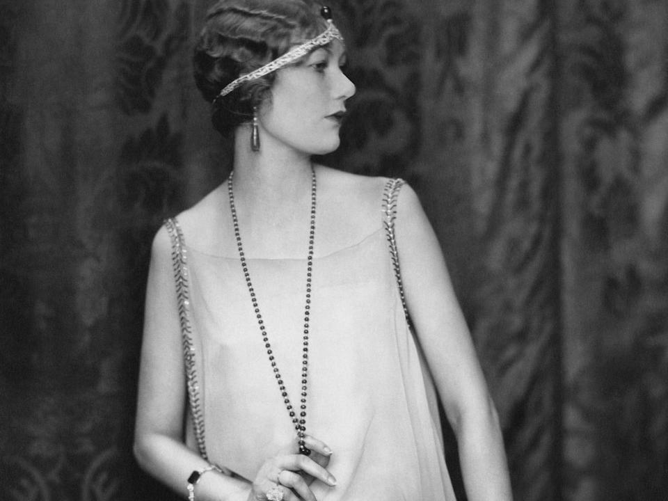 A woman in the 1920s shows off the decade's classic fashion.