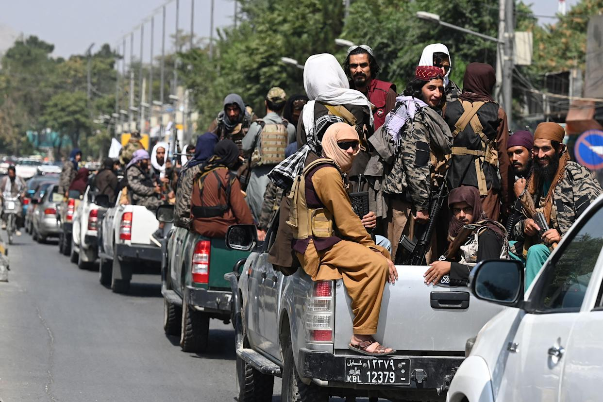 A convoy of Taliban fighters patrol along a street in Kabul on Thursday. (Aamir Qureshi/AFP via Getty Images)