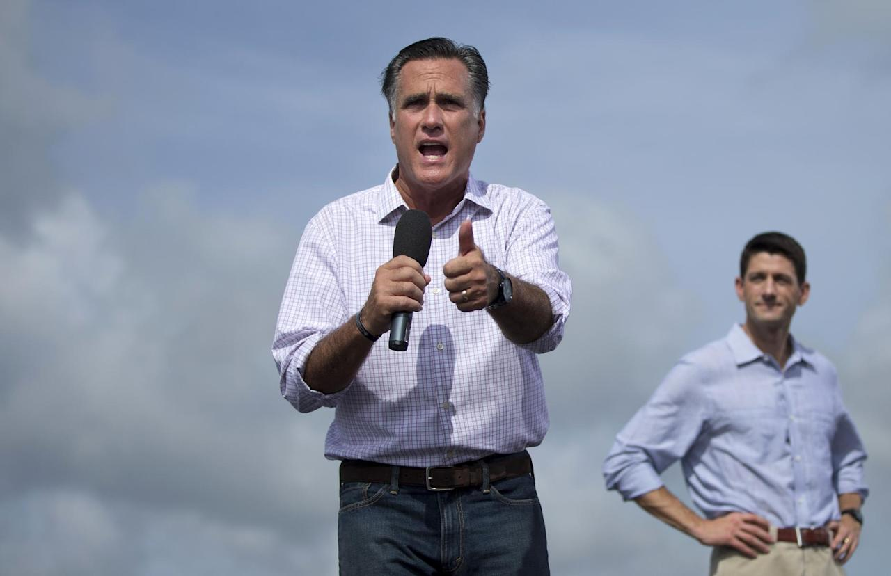 Republican presidential candidate, former Massachusetts Gov. Mitt Romney, accompanied by his vice presidential running mate Rep. Paul Ryan, R-Wis., speaks during a campaign stop, Friday, Aug. 31, 2012, in Lakeland, Fla. (AP Photo/Evan Vucci)