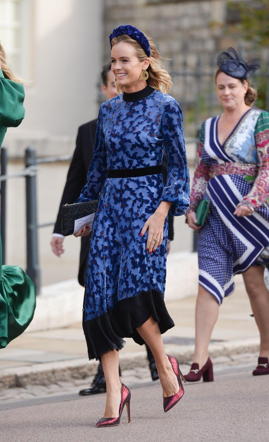 <p>Cressida Bonas' unique velvet midnight blue dress looked cracking paired with the jewel tones of her heels and oversized headband at Princess Eugenie and Jack Brooksbank's nuptials. </p>