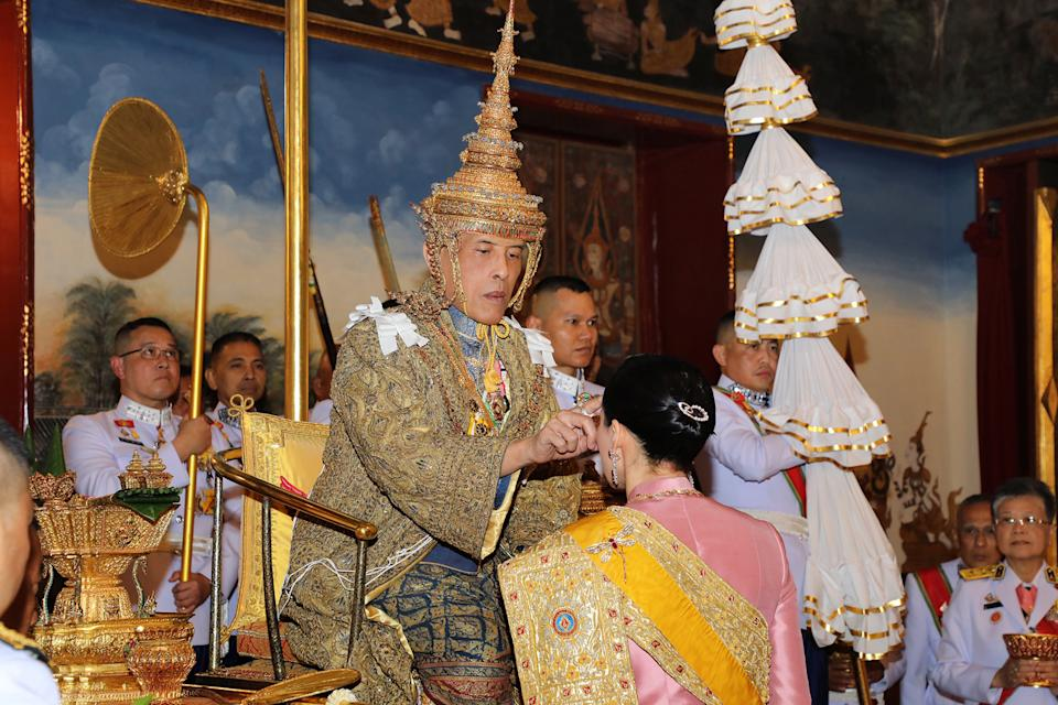 BANGKOK, THAILAND - MAY 04:  In this handout image provided by the Public Relations for the Coronation of King Rama X, Thai King Maha Vajiralongkorn and his wife, Queen Suthida, during the coronation ceremony at the Grand Palace on May 4, 2019 in Bangkok, Thailand. Thailand held its first coronation for the first time in nearly seven decades as King Maha Vajiralongkorn, also known as Rama X, was crowned on Saturday following an extended mourning period for King Bhumibol Adulyadej, who died in October 2016 at the age of 88. The elaborate three-day ceremony reportedly cost around $31 million as King Vajiralongkorn circled around parts of Bangkok on a royal palanquin after being presented with a gold 7.3-kilogram crown and a sacred nine-tiered umbrella. (Photo by Public Relations Department of Thailand via Getty Images)