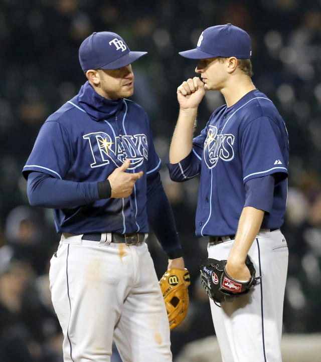 Tampa Bay Rays third baseman Evan Longoria, left, talks to starting pitcher Jake Odorizzi shortly before manager Joe Maddon took Odorizzi out during the fifth inning of a baseball game against the Chicago White Sox Monday, April 28, 2014, in Chicago. (AP Photo/Charles Rex Arbogast)