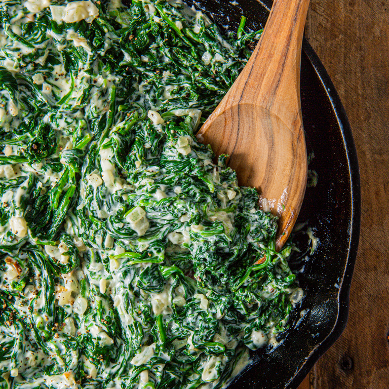 """<p>Creamed spinach is a simple side dish that is also the perfect way to use up any dying spinach. The creaminess will make you forget you're eating spinach and make everyone a fan. It seems like a lot of spinach, but it will boil down into almost nothing so don't skimp on it. </p><p>Get the <a href=""""https://www.delish.com/uk/cooking/recipes/a30425708/easy-creamed-spinach-recipe/"""" rel=""""nofollow noopener"""" target=""""_blank"""" data-ylk=""""slk:Creamed Spinach"""" class=""""link rapid-noclick-resp"""">Creamed Spinach</a> recipe.</p>"""
