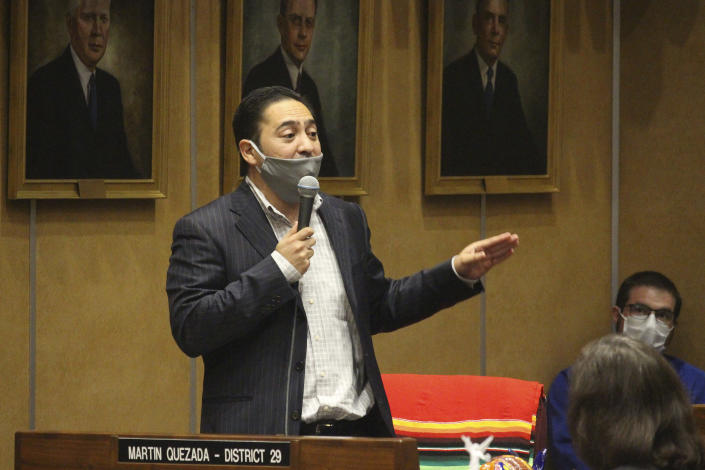 "FILE - In this May 8, 2020, file photo Democratic state Sen. Martin Quezada urges speaks at the state Capitol in Phoenix. Arizona and Texas are both in the final stages of work on contentious pieces of state legislation to tighten voting laws. Quezada, a Latino from Phoenix, didn't back down. ""This will hurt my community. This will hurt my neighborhood."" (AP Photo/Bob Christie, File)"