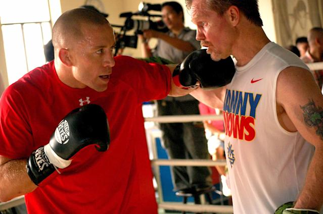 Georges St-Pierre (L) works with Freddie Roach in a training session in 2010. (Getty Images)