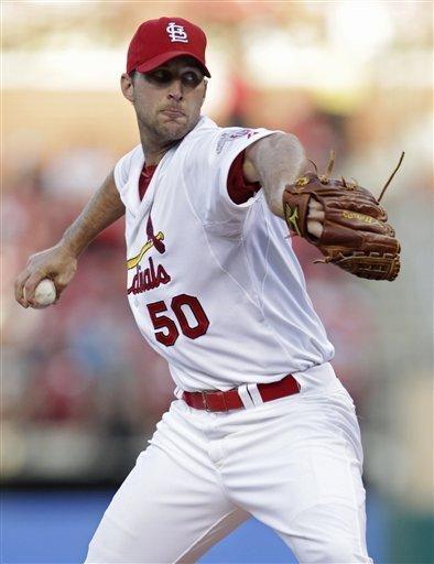 St. Louis Cardinals starting pitcher Adam Wainwright winds up during the first inning of a baseball game against the Chicago White Sox, Tuesday, June 12, 2012, in St. Louis.(AP Photo/Tom Gannam)