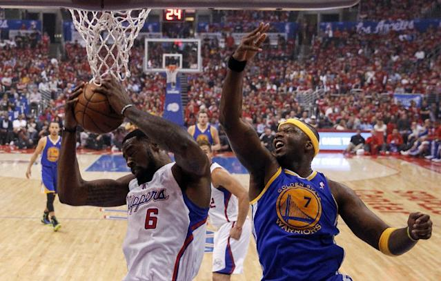 Los Angeles Clippers center DeAndre Jordan, left, pulls a rebound away from Golden State Warriors center Jermaine O'Neal during the first half in Game 2 of an opening-round NBA basketball playoff series in Los Angeles, Monday, April 21, 2014. (AP Photo/Chris Carlson)