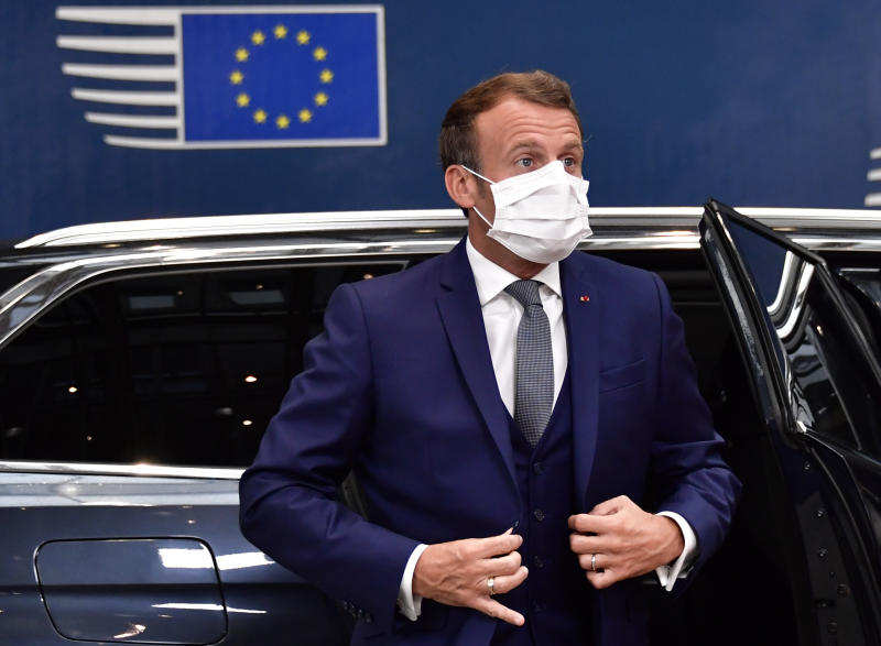 France's President Emmanuel Macron wearing facemask arrives for a European Union Council in Brussels on July 17, 2020, the leaders of the European Union hold their first face-to-face summit over a post-virus economic rescue plan. - The EU has been plunged into a historic economic crunch by the coronavirus crisis, and EU officials have drawn up plans for a huge stimulus package to lead their countries out of lockdown. (Photo by JOHN THYS / POOL / AFP) (Photo by JOHN THYS/POOL/AFP via Getty Images)
