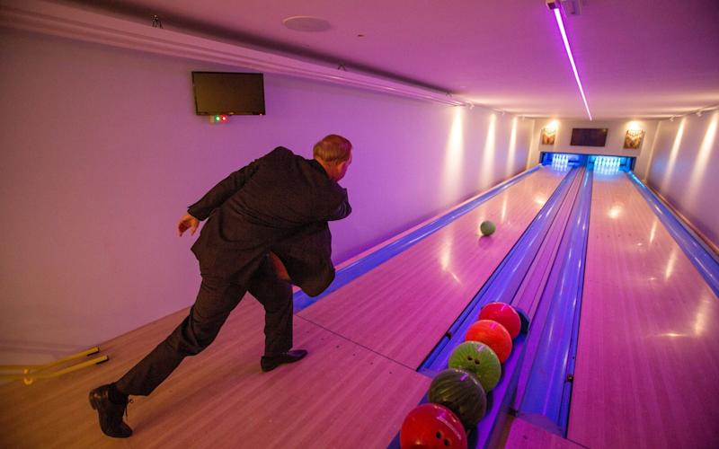 Mr Wildin using the bowling alley in his private leisure centre - SWNS +44 (0)1179066550