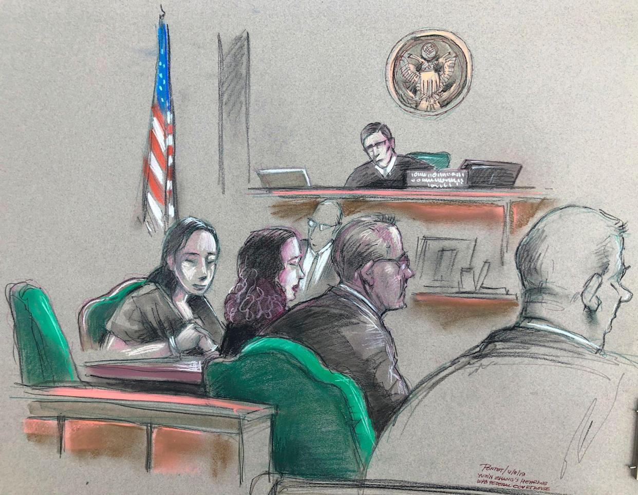 In this artist sketch, Yujing Zhang, left, listens during a hearing on Monday. ( Photo: Daniel Pontet via AP)