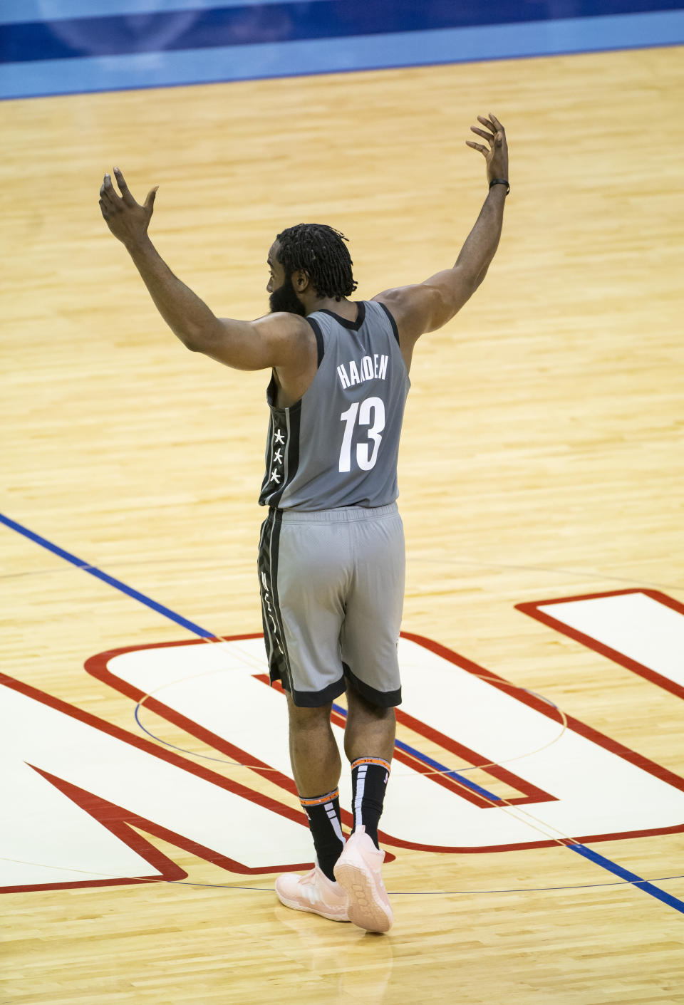 Brooklyn Nets guard James Harden (13) celebrates after an assist during the first half of an NBA basketball game against the Houston Rockets Wednesday, March 3, 2021, in Houston. (Mark Mulligan/Houston Chronicle via AP)
