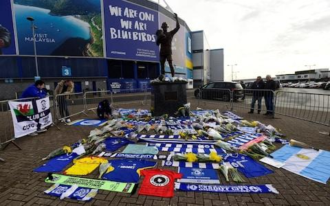 Fans have left scarves and flowers at the Cardiff City stadium