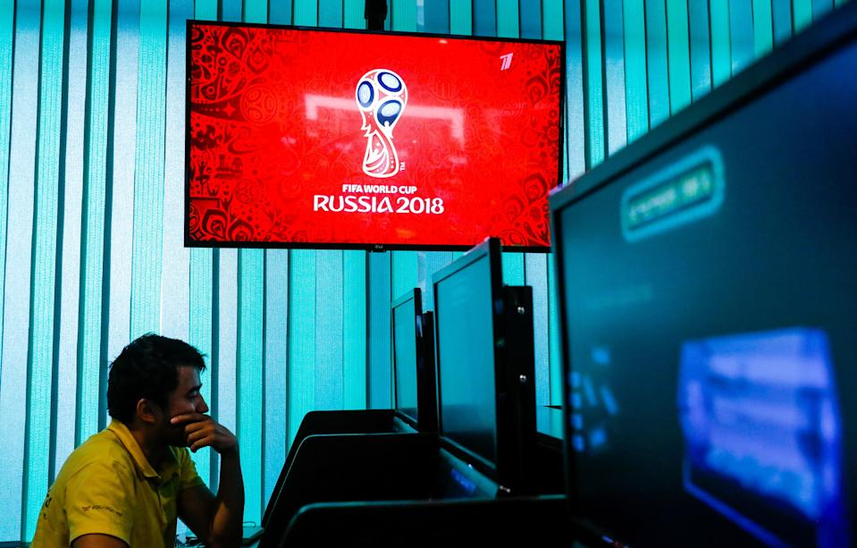 A computer screen shows the 2018 FIFA World Cup emblem in a Moscow branch of Liga Stavok, one of the leading Russian betting companies. (Getty Images)