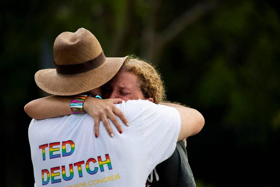 """Rep. Debbie Wasserman Schultz, D-Fla., is comforted after a truck drove into a crowd of people during The Stonewall Pride Parade and Street Festival in Wilton Manors, Fla., Saturday, June 19, 2021. A driver has slammed into spectators at the start of a Pride parade in South Florida, injuring at least two people. Wilton Manors police tweeted Saturday night that the parade was canceled due to a """"tragic event."""""""