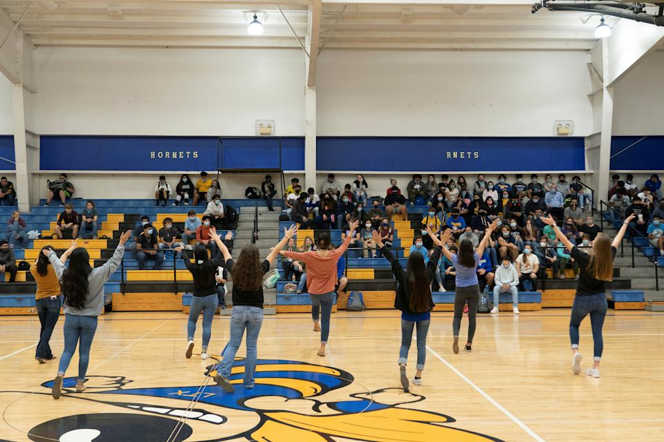 Cheerleaders at Louise High School perform as other students watch during a pep rally, as the COVID-19 pandemic continues in Louise, Texas, on Nov. 20. (Reuters/Go Nakamura)