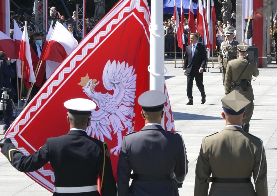 Poland's President Andrzej Duda, right, attends a ceremony commemorating the 100th anniversary of the Battle of Warsaw at the Pilsudski square in Warsaw, Poland, Saturday Aug. 15, 2020. (Janek Skarzynski/Pool via AP)