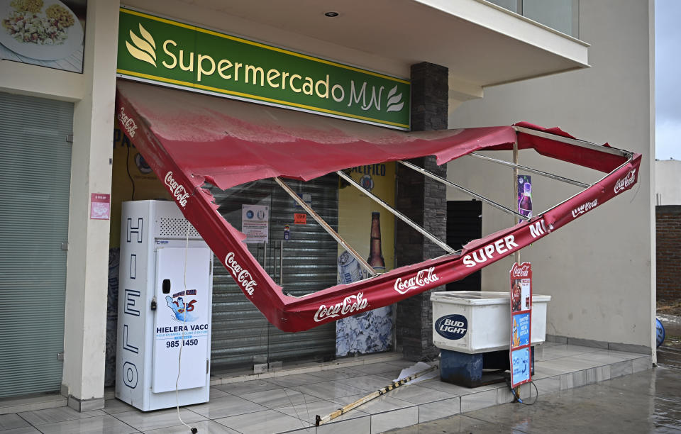 A market's awning is damaged after the passing of Hurricane Pamela in Mazatlan, Mexico, Wednesday, Oct. 13, 2021. Pamela made landfall on Mexico's Pacific coast just north of Mazatlan on Wednesday, bringing high winds and rain to the port city. (AP Photo/Roberto Echeagaray)