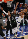 Obi Toppin, right, of the New York Knicks shoots as Josh Okogie, left, of the Minnesota Timberwolves defends during the first half of an NBA basketball game Sunday, Feb. 21, 2021, in New York. (Sarah Stier/Pool Photo via AP)