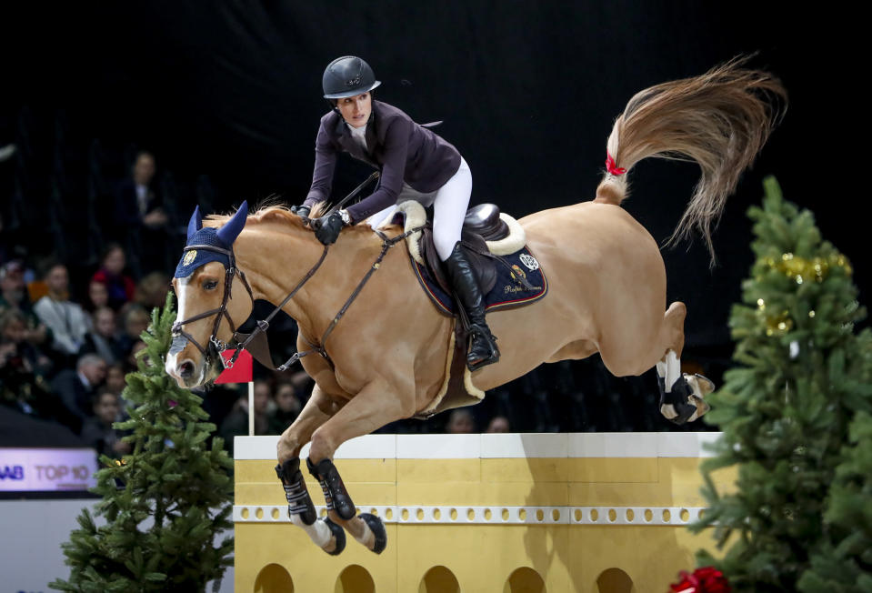 FILE - Jessica Springsteen rides Volage du Val Henry at the Sweden International Horse Show at the Friends Arena in Solna, Sweden, in this Sunday Dec. 1, 2019, file photo. The daughter of rock icon Bruce Springsteen and singer-songwriter Patti Scialfa has been selected as one of four riders on the U.S. jumping team that will compete at the Tokyo Olympics. Twenty-nine-year-old Jessica Springsteen is making her Olympic debut. (Christine Olsson/TT via AP, File)