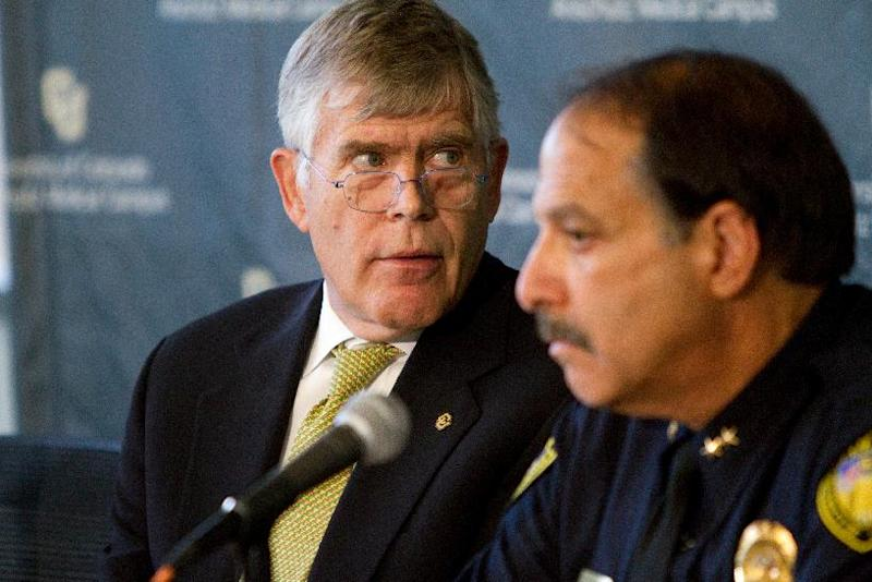 University of Colorado-Denver Chancellor Don Elliman, left, and Doug Abraham, Chief of Police for the University of Colorado, hold a news conference Monday, July 23, 2012, in Aurora, Colo. The conference was called to discuss the program, procedure and policy that surround the Neuroscience program that James Holmes was recently enrolled in before allegedly killing 12 and injuring dozens of others in a shooting at an Aurora, Colo. movie theater last Friday. University officials won't say whether they saw any signs of academic or behavioral trouble in Holmes. (AP Photo/Barry Gutierrez)
