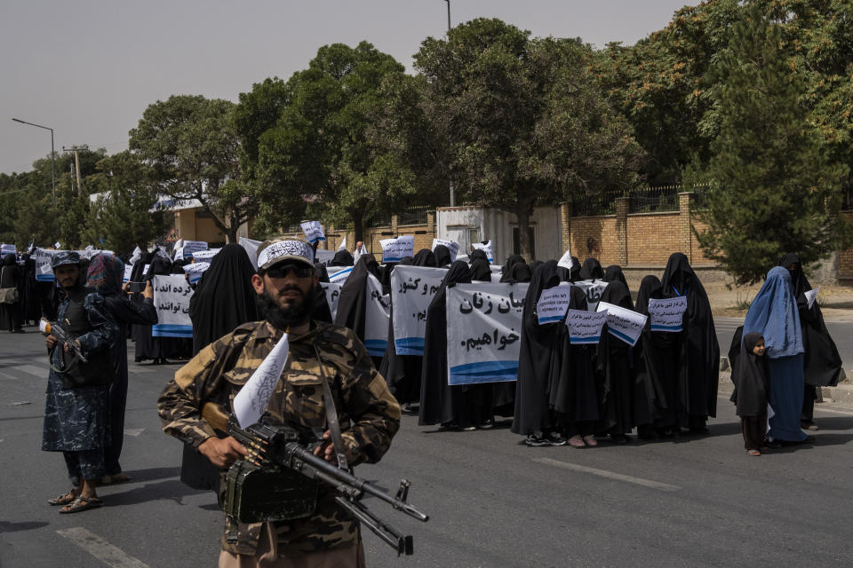 Women march in support of the Taliban government outside Kabul University, Afghanistan, on Saturday, Sept. 11, 2021. (AP Photo/Bernat Armangue)