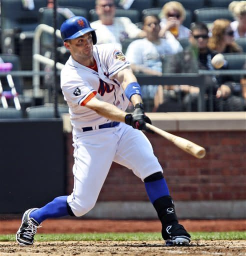 New York Mets' David Wright doubles during the fourth inning of a baseball game against the Miami Marlins, Thursday, Aug. 9, 2012, at Citi Field in New York. (AP Photo/Seth Wenig)