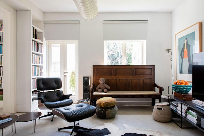 The lounge corner is outfitted with an Eames Lounge Chair and Ottoman, a church pew sourced from a local antique shop, and a smattering of Broudo's knitting projects. The painting is by local artist Erez Golan.