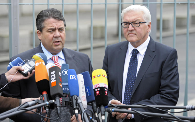 Faction leader of the oppositional German Social democrats, SPD, Frank-Walter Steinmeier, right, and Head of the SPD Sigmar Gabriel, left, speak to media after their negotiations with the coalition government in Berlin, Germany, Thursday, June 21, 2012. German opposition leaders say they have reached a deal with Chancellor Angela Merkel's governing coalition that will allow them to ratify Europe's budget discipline pact. Merkel needs opposition support to secure the needed two-thirds majority in Parliament for the pact. (AP Photo/dapd Michael Gottschalk)
