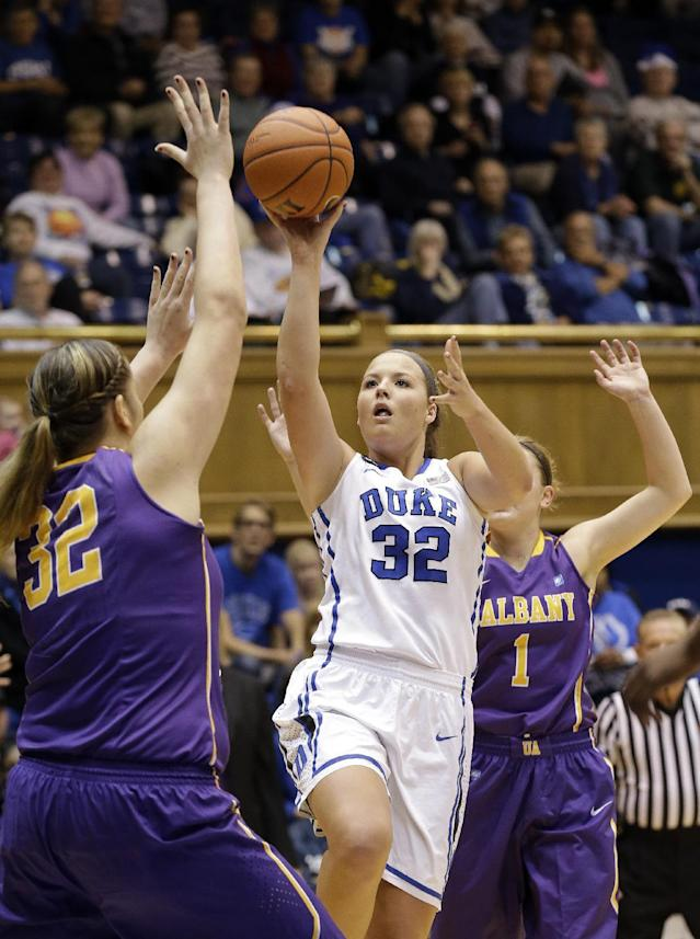 Duke's Tricia Liston (32) shoots as Albany's Megan Craig (32) and Erin Coughlin (1) defend during the first half of an NCAA college basketball game in Durham, N.C., Thursday, Dec. 19, 2013. (AP Photo/Gerry Broome)