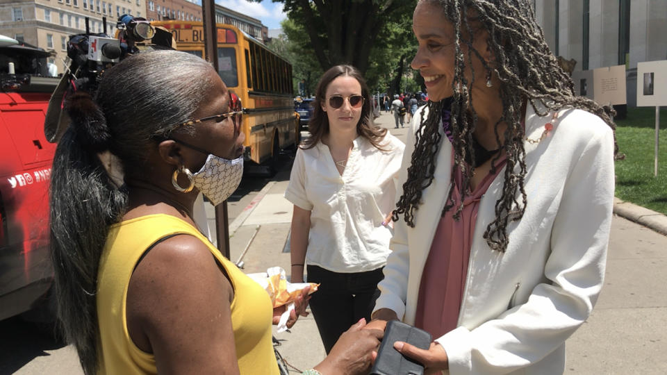 Maya Wiley speaks to a voter outside the Brooklyn Central Library on Tuesday, June 15. The voter, who gave her name only as Dee, said she is going to vote for either Wiley or Eric Adams. She said she does not want the next mayor to defund the police but does want the police department to be reformed. (Jon Ward/Yahoo News)
