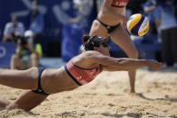 Sarah Sponcil, of the United States, competes during a women's beach volleyball match against Canada at the 2020 Summer Olympics, Sunday, Aug. 1, 2021, in Tokyo, Japan. (AP Photo/Felipe Dana)