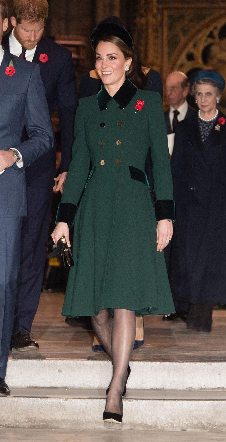 """<p>The Duchess <a href=""""https://www.townandcountrymag.com/style/fashion-trends/a24851861/kate-middleton-black-coat-pippy-pin-remembrance-sunday-2018-photos/"""" rel=""""nofollow noopener"""" target=""""_blank"""" data-ylk=""""slk:wore a dark green coat by Catherine Walker"""" class=""""link rapid-noclick-resp"""">wore a dark green coat by Catherine Walker</a> for the centenary of World War I armistice service at Westminster Abbey in London. Once again, Kate wore a poppy pin on her coat, a symbol of remembrance.<br></p>"""