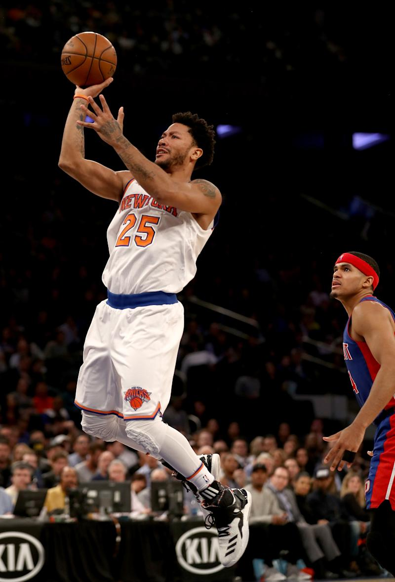 Basketball - Rose out for rest of season after knee injury