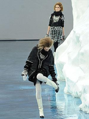<p>A model adjusts her heel as she tries to naviagte the slippery floor at the Chanel Ready to Wear show as part of the Paris Womenswear Fashion Week.</p>