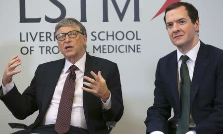 Microsoft co-founder Bill Gates speaks as he sits with Britain's Chancellor George Osborne during a visit to the Liverpool School of Tropical Medicine in Liverpool