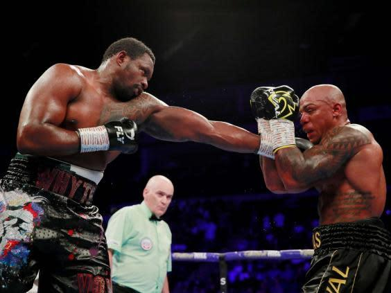 Whyte and Rivas trade shots (Action Images via Reuters)