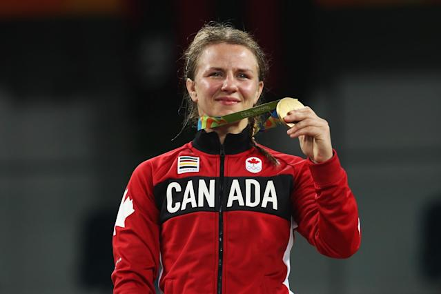 "<p>The 27-year-old from Ottawa dominated Guzel Manyurova of Kazakhstan to win Olympic gold in the final of the 75-kilogram category and continue Canada's medal streak in women's wrestling. With the victory, Wiebe follows in the footsteps of two-time Olympic medallist Carol Huynh, the winner of Canada's first-ever gold in women's wrestling in Beijing eight years ago, and Tonya Verbeek, who finished on the podium at three separate Games. Click <a href=""https://ca.sports.yahoo.com/news/canadian-wrestler-erica-wiebe-advances-161830744.html"" data-ylk=""slk:here"" class=""link rapid-noclick-resp newsroom-embed-article"">here</a> to read more. </p>"